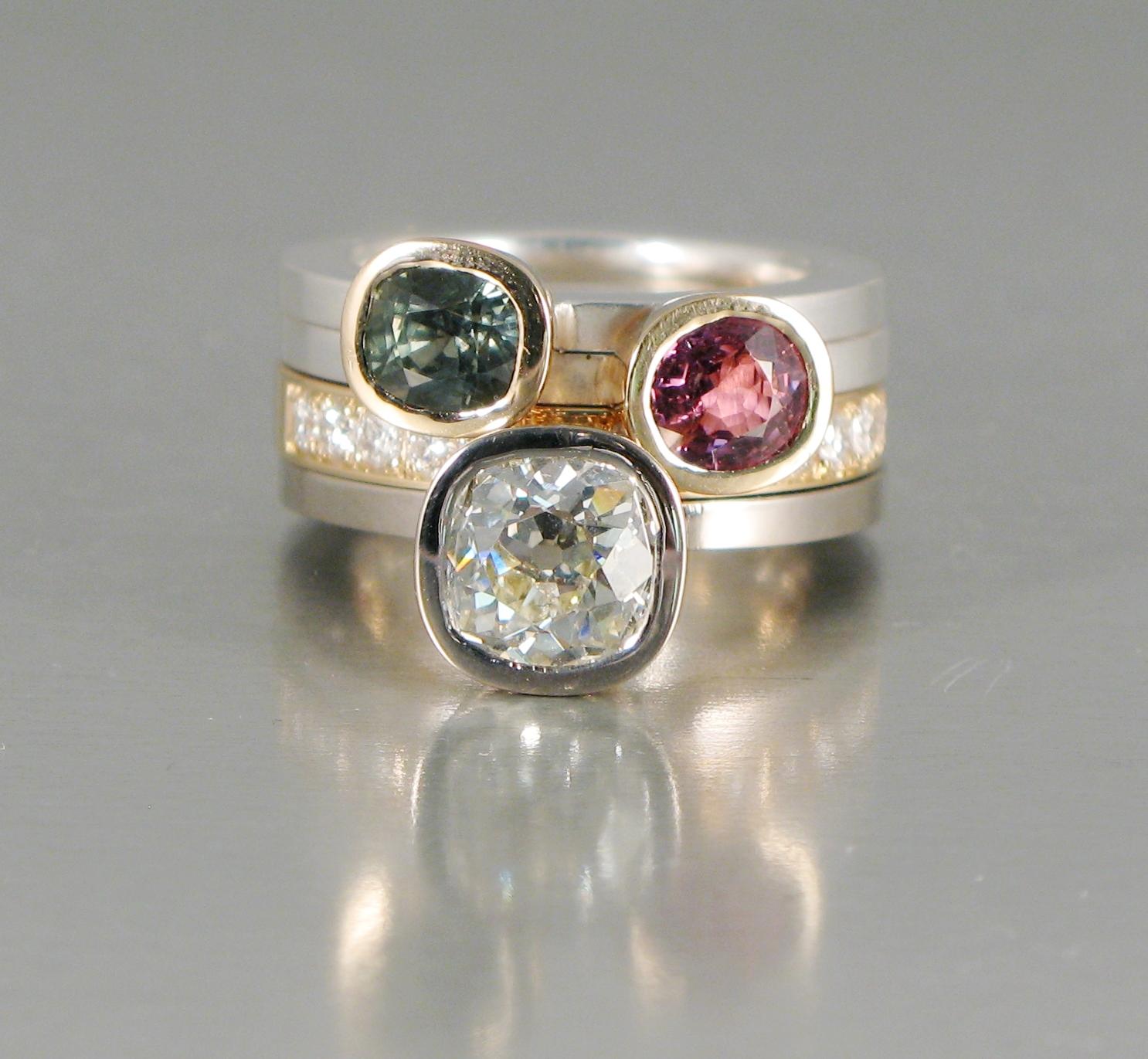 """Ring, """"Pusselringar"""", vitt och rött guld, silver, diamant, safir och turmalin."""