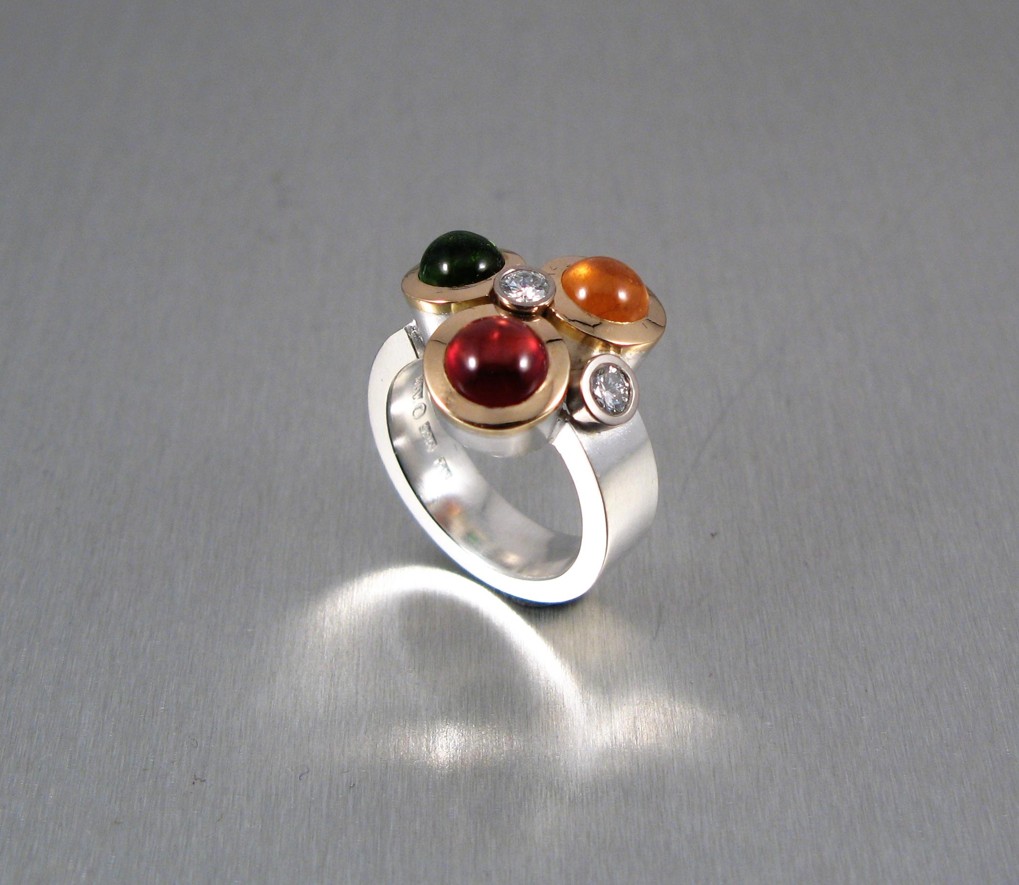 Ring, silver, guld, diamanter, turmalin, granat och spessartit.