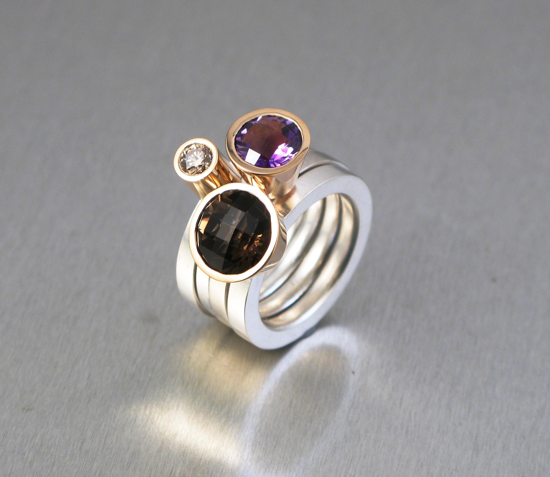 """Ringar, """"Pusselringar"""", silver och guld med diamant, rökkvarts och ametist."""