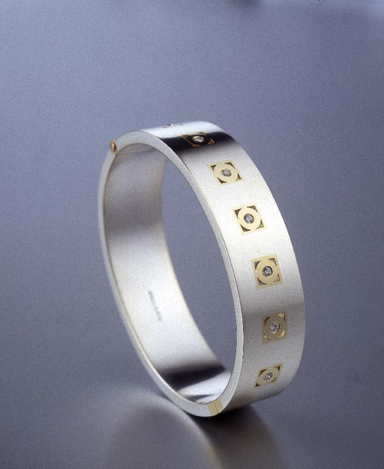 Stel armring i silver och guld