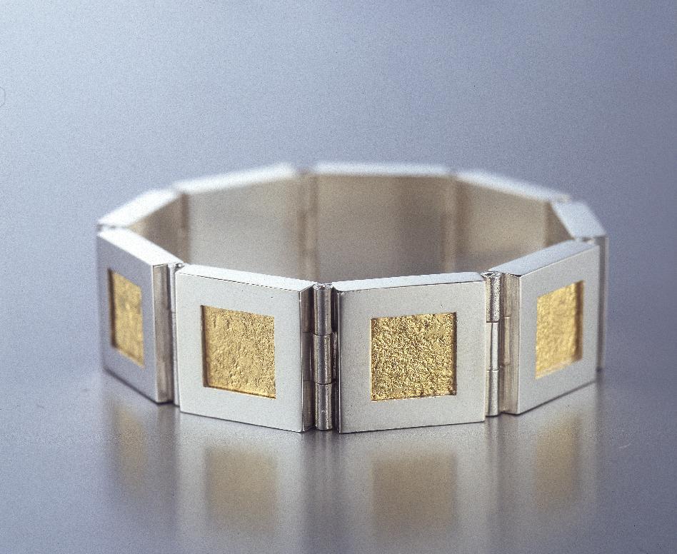 Ledat armband i silver och guld